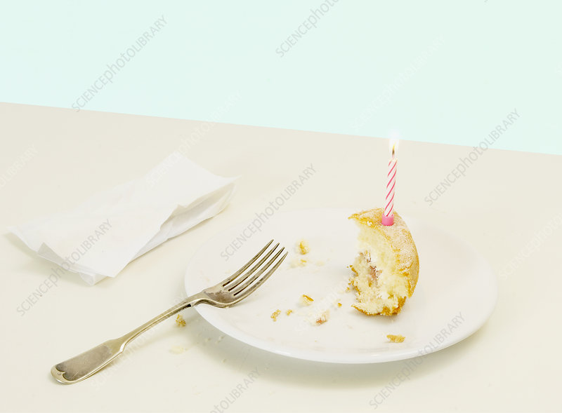 half eaten birthday cake with candle