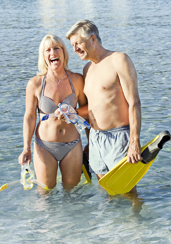 Senior couple with snorkels in the sea