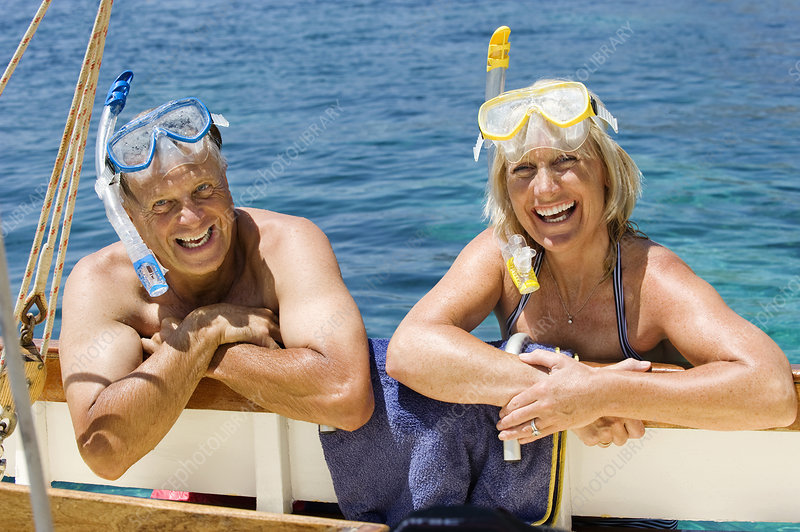 A senior couple with snorkels