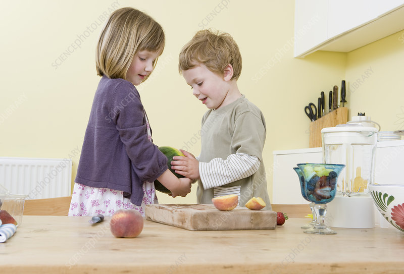 boy and girl preparing fruit