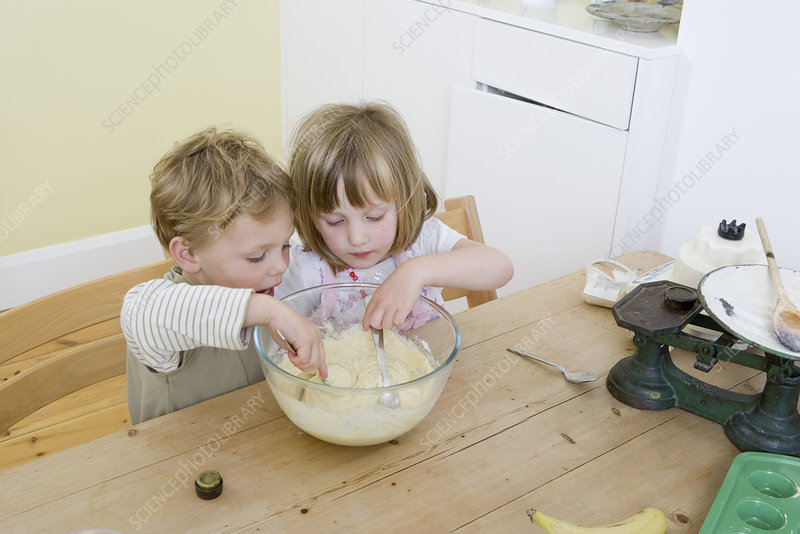 boy and girl mixing cake