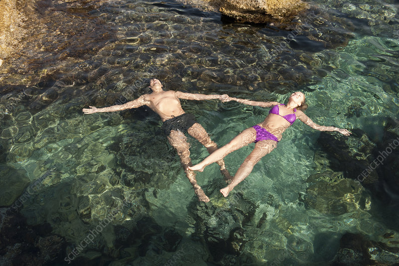 Young Couple Floating in the Sea