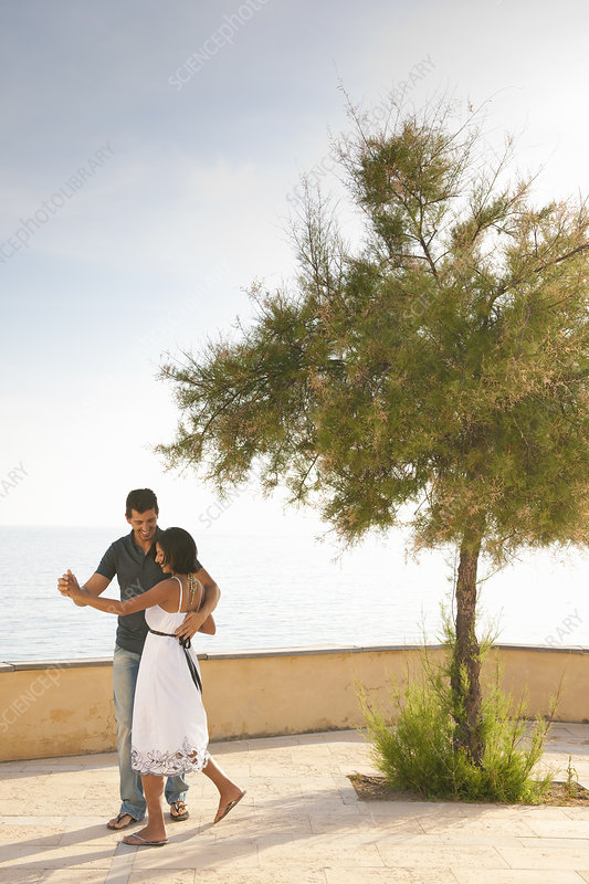 Romantic Couple Dancing by the Ocean