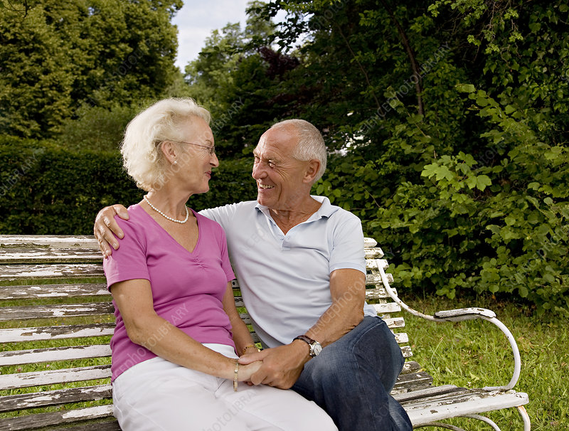 senior man and woman on old bench