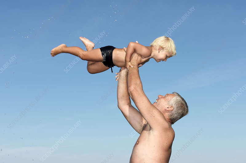 Grandfather playing with boy