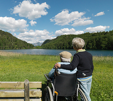 Senior couple relaxing by lake