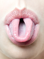 Woman rolling her tongue