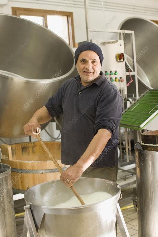 Worker producing bison mozzarella