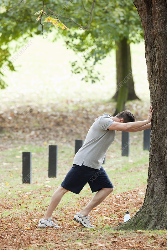 Man stretching for a workout in the park