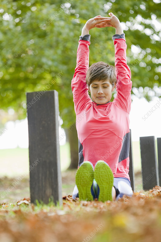 Woman stretching in park before workout