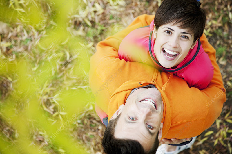 Man and woman embrace in park workout