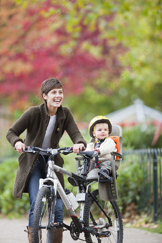 Woman and child cycling in the park