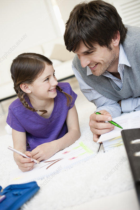 Father and girl doing paperwork