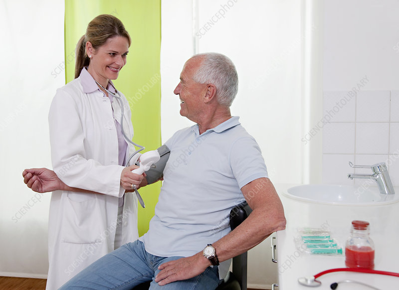 Doctor patient's taking blood pressure