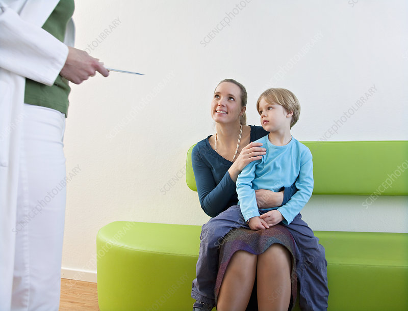 Doctor with patient in waiting area