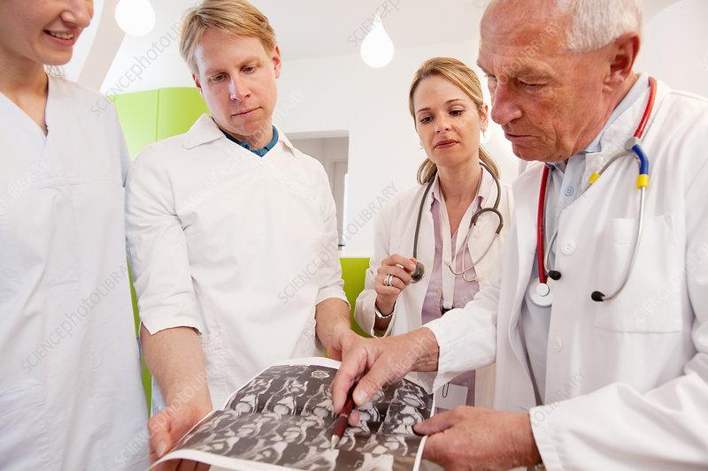 Doctors studying CAT scan
