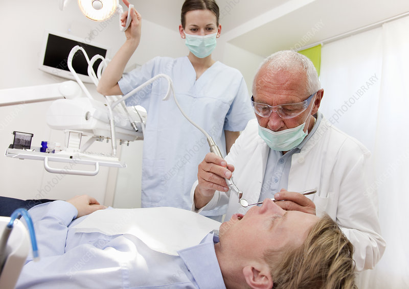 Dentist with patient in surgery