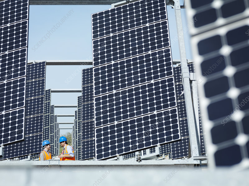 Spanish solar power station with workers