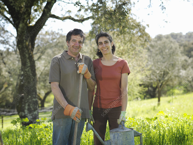 Man and woman posing with watering can