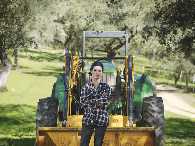 Woman standing in front of tractor