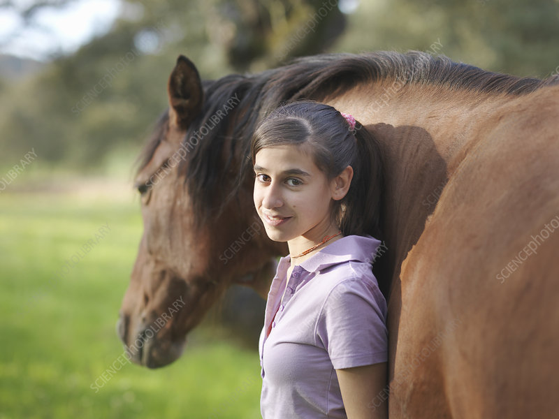 Girl posing with her horse