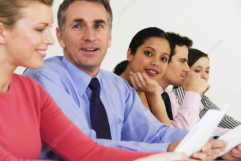 Happy women looks at camera in meeting