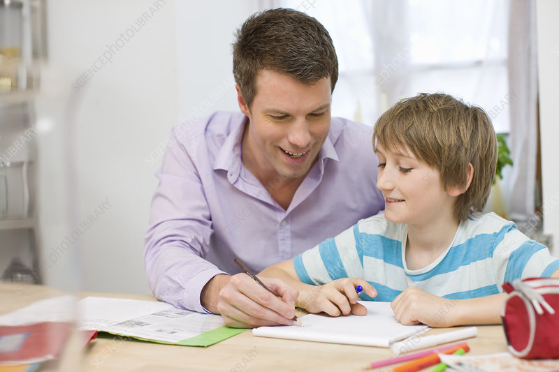 Father and son doing homework