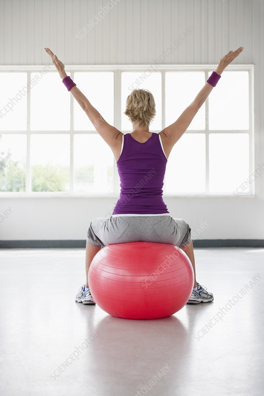 Woman sitting on gymball