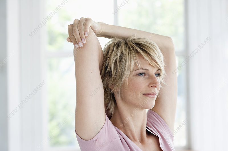 Woman stretching arms portrait