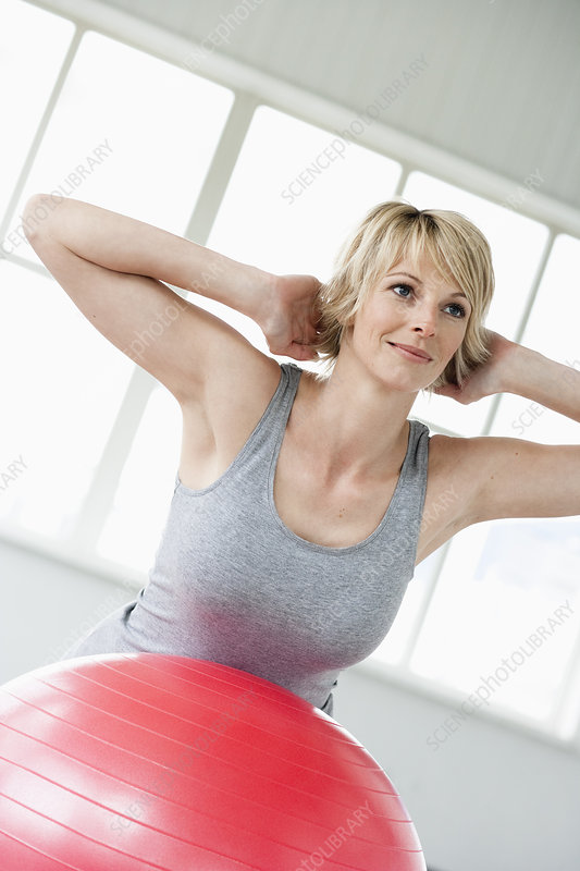 Woman exercising on gymball