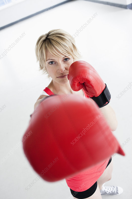 Woman boxing into camera