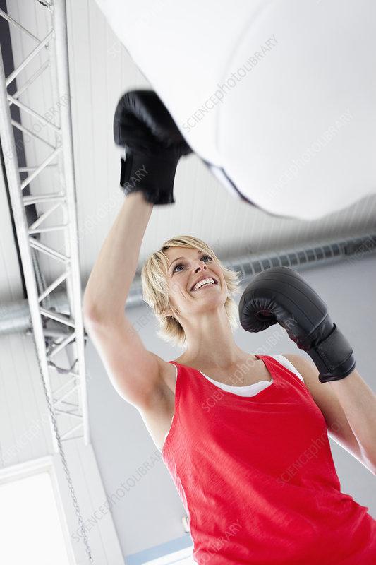 Woman boxing punching bag