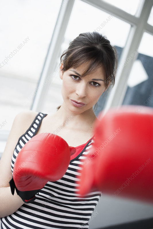 Woman boxing to camera