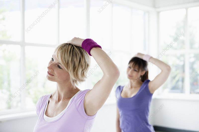 Two women stretching neck