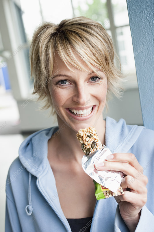 Woman eating power bar