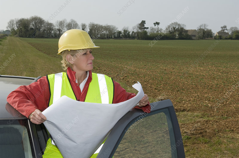Female surveying countryside