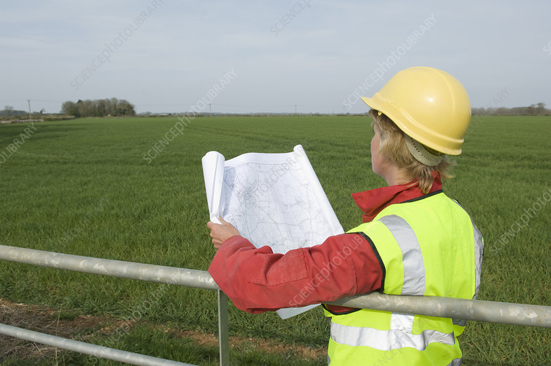 Female surveying countryside
