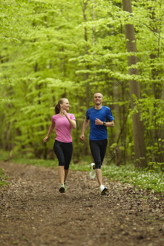 Man and woman running, together