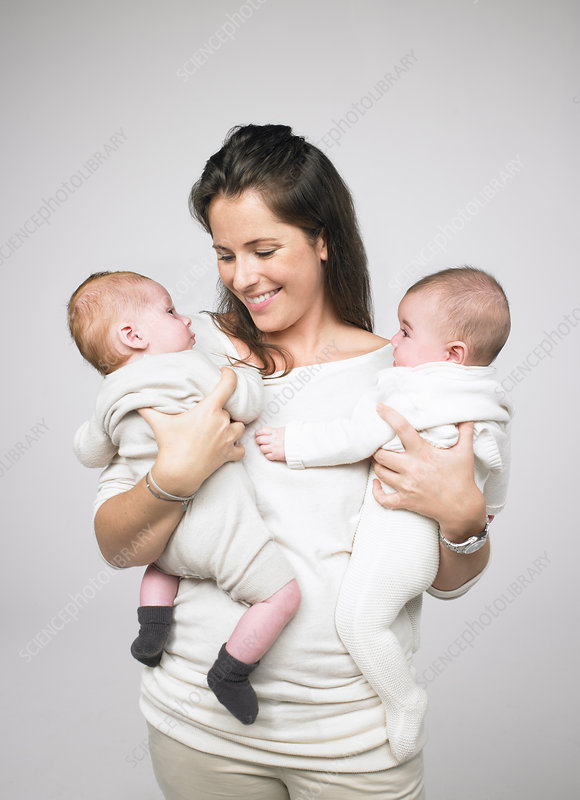 Mother holding two babies