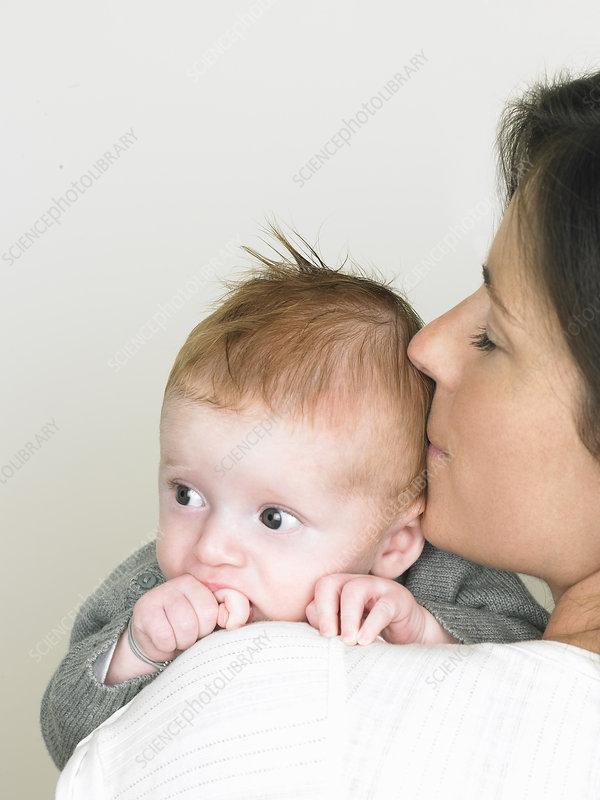 Baby on mothers shoulder