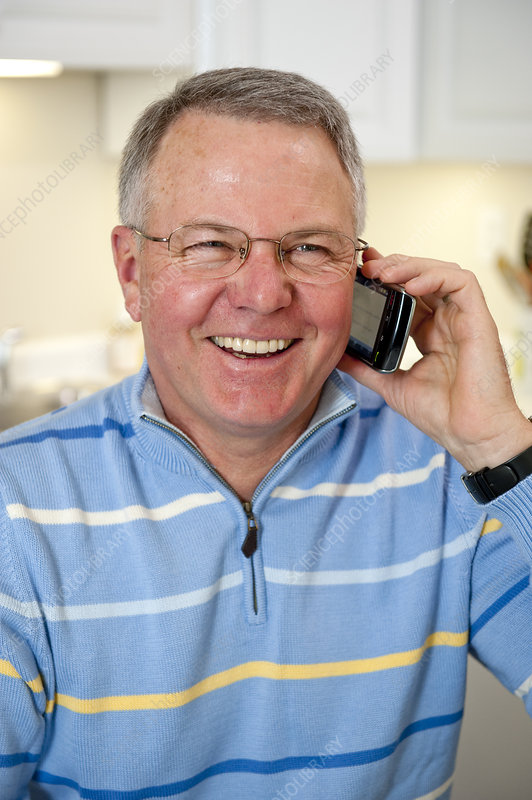 Mature man talking on cell phone