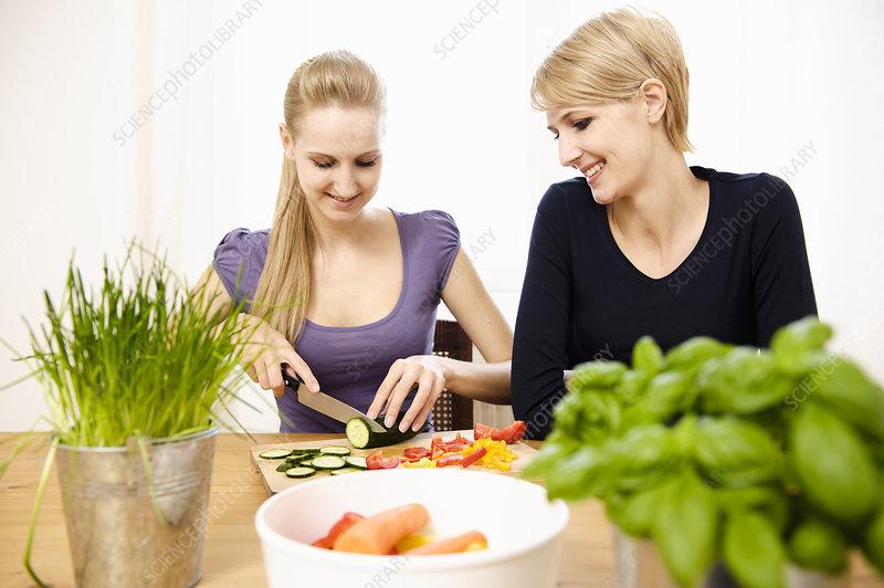 Young Women Preparing Food, eating