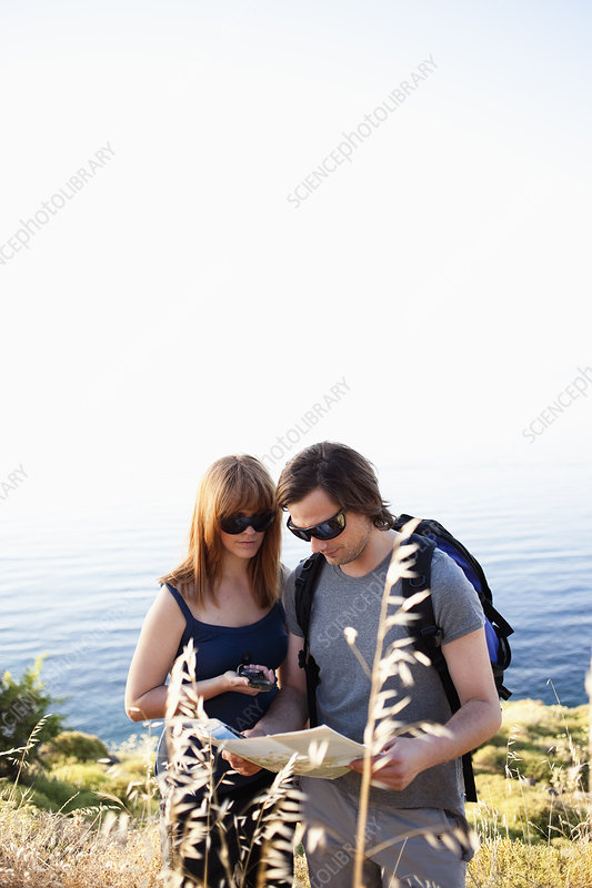 Young couple looking at compass