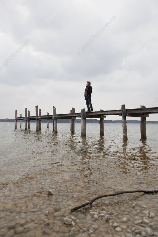 Man standing on landing stage