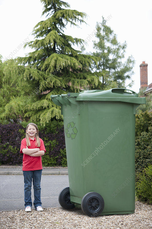 Young Girl With Recycling Bin