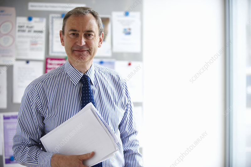 Male Medical consultant holding papers