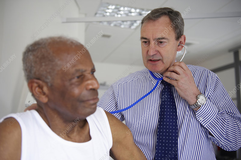 Doctor with stethoscope with elderly man