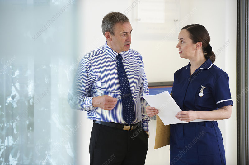 Nurse and Doctor talking in room