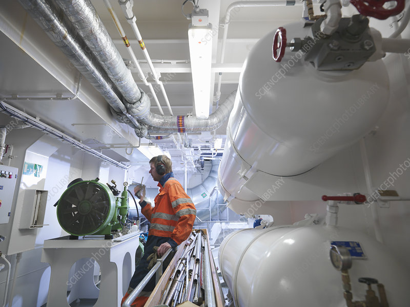 Engineer in ship's engine room