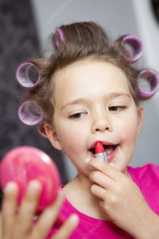 Little Girl using lipstick